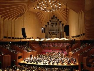 Sydney-Symphony-Orchestra-with-6-harps-at-the-Sydney-Opera-House-Concert-Hall.jpg
